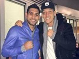 amir khan is a hit with shkodran mustafi and mesut ozil despite arsenal suffering knockout in league cup