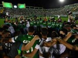 Chapecoense players and fans pay tribute to plane crash victims at their home stadium in Brazil on night they were due to play inCopa Sudamericana final