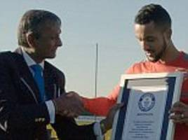 Theo Walcott becomes Guinness World Record holder after beating Arsenal stars in challenge to control football dropped from 34m high crane