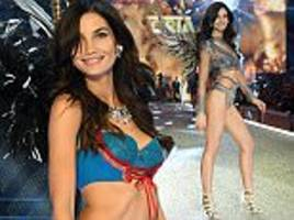 Lily Aldridge sends pulses racing in sizzling metallic number and racy blue lace lingerie as she struts down Victoria's Secret Fashion Show in Paris