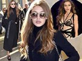 Gigi Hadid swaps lingerie for chic winter coat in Paris after Victoria's Secret runway