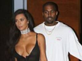 Kanye West has 'checked out of hospital and is now back home with Kim Kardashian and family' over a week after breakdown