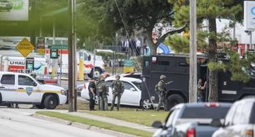 The Latest: No Hostages Shot in Fla. Bank Robbery