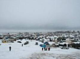protesting in the snow: dakota pipeline activists face bitter winter with temperatures set to fall to 4 degrees as supporters are told they'll be fined $1,000 if they take supplies to the camp