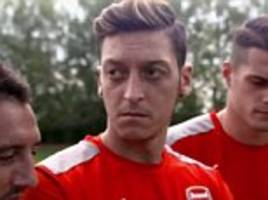Arsenal star Mesut Ozil tries and fails to pull off Daniel Sturridge's wonder goal for Liverpool in the 2016 Europa League final