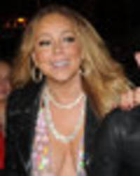 Mariah Carey flashes nether regions with major wardrobe fail