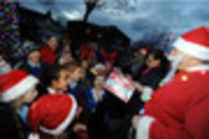 Families gather as Christmas lights are switched on in Carlton