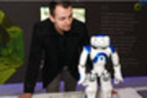 Tiny dancing robot steals the show at ceremony for £30m...
