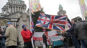 dozens gather at belfast city hall to mark anniversary of union flag protests