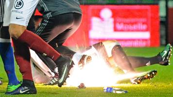 French game off after firecrackers thrown at goalkeeper