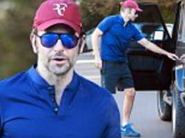 Bradley Cooper shows off fit figure in tight shirt amid speculation he is soon to be a father
