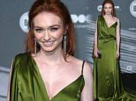 Emerald Demelza! Eleanor Tomlinson looks striking in a satin green gown that accentuates her blazing red tresses and porcelain complexion at British Independent Film Awards