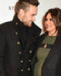 liam leaves 'pregnant' cheryl behind as he flies to la to record new music