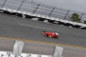 f1 car hits the banks at daytona for first time