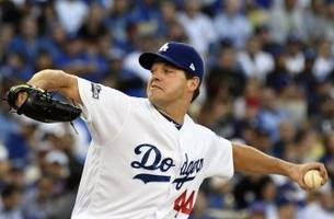 los angeles dodgers re-sign rich hill to three year contract