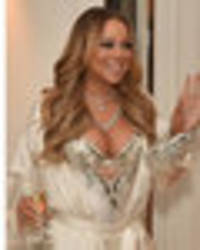 Ready for the bedroom: Mariah Carey shows off curves in saucy night-time lingerie