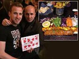 tottenham star harry kane celebrates spurs' rout over swansea with family meal at favourite chigwell restaurant
