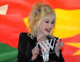 dolly parton's generosity continues with telethon for tennessee fire victims