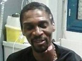 former liverpool defender rigobert song pictured in hospital on road to recovery after life-threatening coma… wearing a southport under-21 shirt