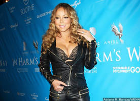 Mariah Carey Suffers Another Nip Slip as She and Bryan Tanaka Cozy Up at NYC Hot Spot