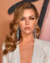 Abbey Clancy wows at Fashion Awards in extreme boob-baring frock