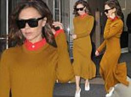 Victoria Beckham wows in knitted mustard dress with orange collar in New York