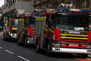 CCTV footage of firefighters being verbally abused by a group of youths while tackling a blaze has been handed to police
