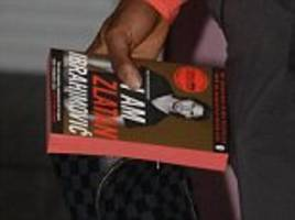Timothy Fosu-Mensah takes Zlatan Ibrahimovic's autobiography to read on Manchester United's flight to face Zorya Luhansk in Ukraine