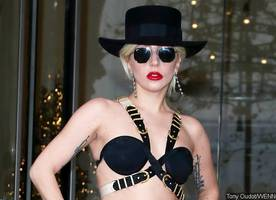 lady gaga steps out in bizarre tiny bra and very high heels in london