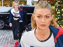 Gigi Hadid shows off her abs as she leaves her NYC