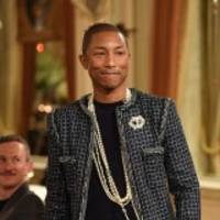 pharrell hits the runway at chanel fashion show in paris