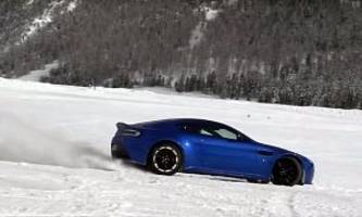 aston martin vantage drifting in the snowy alps is savage v12 fun