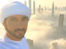 crown prince of dubai shares footage of skyscrapers rising through a blanket of mist