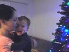 terrified toddler bursts into tears when he sees the family christmas tree