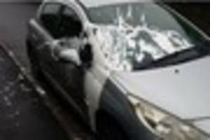 vandals throw white paint over silver peugeot 207 in crewkerne