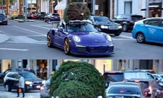 porsche 911 gt3 rs hauling a christmas tree becomes ultraviolet blue decoration