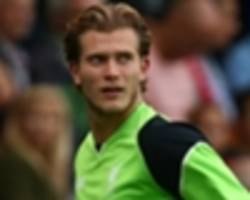 'a failed manager hasn't a clue!' - neville continues war of words with karius