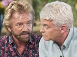 noel edmonds reignites feud with phillip schofield after cancer interview on this morning
