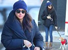 there's snow stopping her! prince harry's girlfriend meghan markle wraps up as she takes her dog bogart to the vet in the icy conditions of toronto