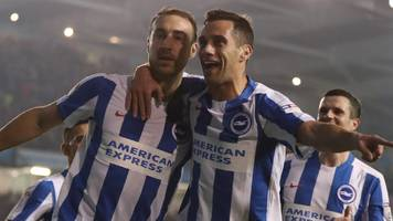brighton go top with win over 10-man leeds