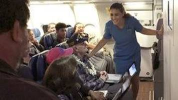 Pearl Harbor survivor gets dance from Mrs. Hawaii America on flight