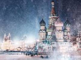 from russia with lovely photographs: the dazzling snow storm images of moscow that show just how magical it can look in winter