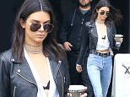 kendall jenner flashes her bra in sexy white top and jeans after stripping to her lingerie for the victoria's secret fashion show