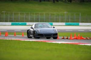 porsche brings the media driving academy to sepang, malaysia