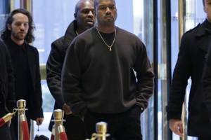 kanye west shows off trump-autographed time magazine cover