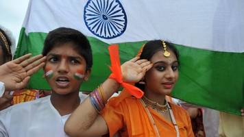 indian writer held for 'insulting' national anthem