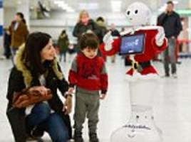 computer says... jingle bells! travellers at glasgow airport are being greeted by a christmas carol-singing robot