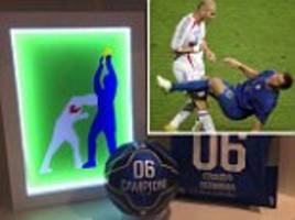 marco materazzi shows off picture of his most famous moment when zinedine zidane headbutted him... but here the italian is holding world cup