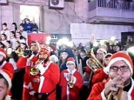 assad loyalists in aleppo dress up as santa and celebrate christmas in the square