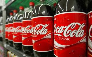 coca-cola gulps down stake in ab inbev's africa unit for $3.2bn